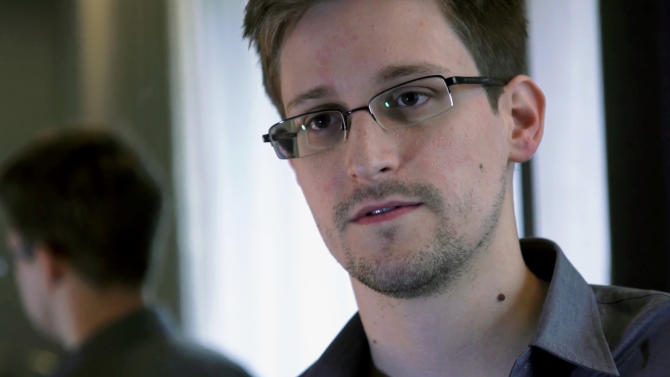 FILE - This June 9, 2013 photo provided by The Guardian newspaper in London shows Edward Snowden, who worked as a contract employee at the U.S. National Security Agency, in Hong Kong. The Guardian newspaper says that the British eavesdropping agency GCHQ repeatedly hacked into foreign diplomats' phones and emails when the U.K. hosted international conferences, even going so far as to set up a bugged Internet café in an effort to get an edge in high-stakes negotiations. The Guardian cites more than half a dozen internal government documents provided by former NSA contractor Edward Snowden as the basis for its reporting on GCHQ's intelligence operations. (AP Photo/The Guardian, File)