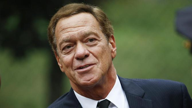 "FILE - In this Sept. 29, 2015 file photo, comedian Joe Piscopo arrives at Church of the Immaculate Conception prior to funeral services for New York Yankees Hall of Fame catcher Yogi Berra in Montclair, N.J.  A woman has admitted stealing money from the former ""Saturday Night Live"" cast member. Under terms of a plea agreement, Jennifer LaRocca pleaded guilty to theft. LaRocca admitted her husband was hired to pay Piscopo's bills and she unlawfully wrote checks for her own expenses using the funds between 2010 and 2014.  (AP Photo/Julio Cortez)"