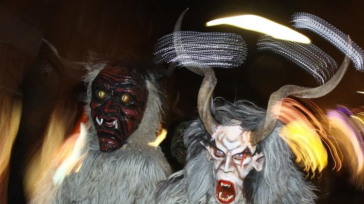 Costumed participants in a Perchten parade perform in Vienna
