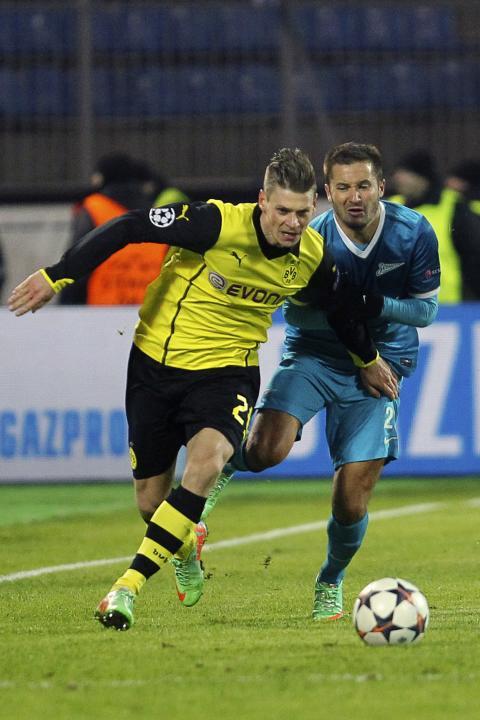 Zenit St Petersburg's Fayzulin fights for the ball with Borussia Dortmund's Piszczek during their Champions League soccer match in St. Petersburg