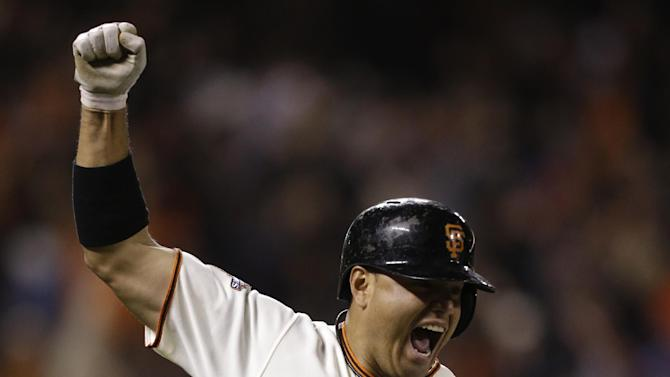 San Francisco Giants' Guillermo Quiroz celebrates as he rounds the bases after hitting a walkoff home run in the tenth inning of a baseball game against the Los Angeles Dodgers Saturday, May 4, 2013, in San Francisco. (AP Photo/Ben Margot)