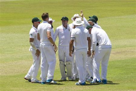 South Africa's players celebrate the wicket of India's Shikhar Dhawan during the first day of the second cricket test match in Durban