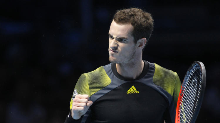 Andy Murray of Britain celebrates after he plays a return to Jo-Wilfried Tsonga of France during their singles tennis match at the ATP World Tour Finals in London Friday, Nov. 9, 2012. (AP Photo/Sang Tan)