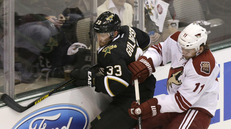 Dallas Stars' Alex Goligoski (33) and Phoenix Coyotes' Martin Hanzal vie for the puck during the second period of an NHL hockey game Saturday, Jan. 19, 2013, in Dallas.  (AP Photo/LM Otero)