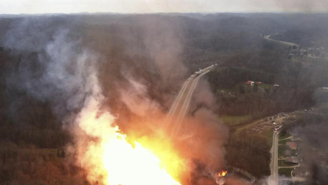 FILE - In this image Dec. 11, 2012 file photo, provided by the West Virginia State Police, shows a fireball erupting across Interstate 77 from a gas line explosion in Sissonville, W.Va. Accident investigators issue a report and safety recommendations based three powerful gas transmission line explosions in California, Florida and West Virginia. In each case, the gas company failed conduct inspections or tests that might have revealed weaknesses in the massive pipelines. In the California accident, 9 people were killed and 70 homes destroyed. In the West Virginia incident, the stretch of pipeline that ruptured, igniting a fire that destroyed three homes and damaged several others, hadn't been inspected or tested for 24 years.   (AP Photo/West Virginia State Police)