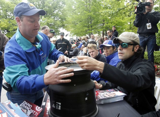 Target Chip Ganassi Racing driver Dario Franchitti signs autographs for fans at the Indianapolis Motor Speedway in Indianapolis