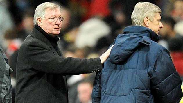 Manchester United manager Sir Alex Ferguson (left) with Arsenal manager Arsene Wenger after the final whistle.