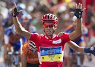 Spain's Alberto Contador (C) of the Saxo Bank-Tinkoff Bank Team celebrates after crossing the finish line of the Vuelta cycling Tour of Spain, in Madrid, on September 9. Contador has emerged from a triumphant Tour of Spain campaign to show he still has the legs with victory in the Milan-Turin, Italy's oldest cycling race