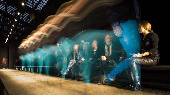 In this photo made with a long exposure, a model walks the runway before the Rag & Bone Fall 2013 fashion show at Skylight Studios, Friday, Feb. 8, 2013, in New York. (AP Photo/John Minchillo)