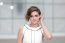 Actress Kristen Stewart poses for photographers as she arrives for Chanel 's Spring-Summer 2015 Haute Couture fashion collection, presented in Paris, France, Tuesday, Jan. 27, 2015. (AP Photo/Thibault Camus)