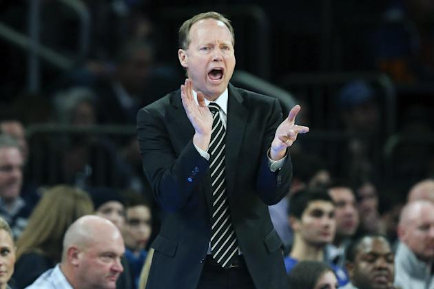 Atlanta Hawks head coach Mike Budenholzer directs his players from the bench during the first half of an NBA basketball game against the New York Knicks on Saturday, Dec. 14, 2013, in New York