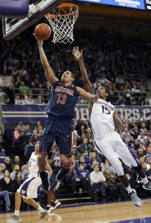 No. 8 Arizona holds off Washington 57-53