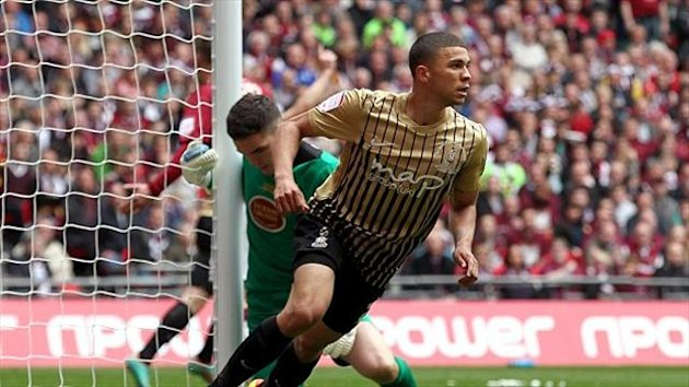 Bradford City striker Nahki Wells rescued a point for his side with a late free-kick against leaders Leyton Orient