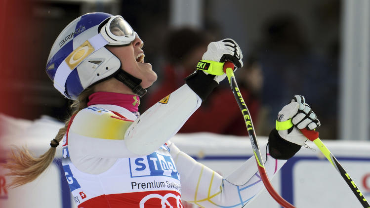 Lindsey Vonn, right, of the United States, shouts in celebration after winning an alpine ski, women's World Cup super-G, in St. Moritz, Switzerland, Saturday, Dec .8, 2012. (AP Photo/Giovanni Auletta)