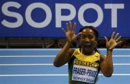 Jamaica's Shelly-Ann Fraser-Pryce celebrates after winning the women's 60m final in the world indoor athletics championships at the ERGO Arena in Sopot March 9, 2014. REUTERS/Kai Pfaffenbach