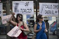 People demonstrate against banking abuses on June 02, in Madrid. Spain's distressed banks need about 40 billion euros ($50 billion) in new capital, the IMF warned, ramping up the pressure for a huge EU bailout amid fears of widespread contagion