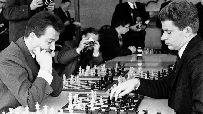 FILE - Svetozar Gligoric, left, of Yugoslavia, and Boris Spassky, of the USSR, are shown during a game on the opening day of the 41st annual International Chess Congress, in this Dec. 29, 1965 file photo taken in Hastings, Sussex, England. Gligoric, a legendary Serbian and Yugoslav chess player and one of the world's top players in the 20th century, died Tuesday Aug. 14, 2012 and was buried in the Serbian capital on Friday. He was 89. (AP Photo)