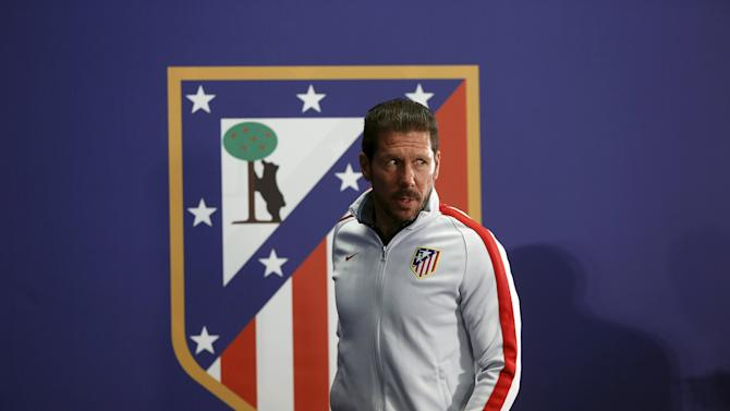 Atletico Madrid's coach Simeone arrives for a news conference at Vicente Calderon stadium in Madrid