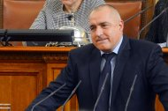 Bulgarian Prime Minister Boiko Borisov speaks in the Parliament in Sofia February 20, 2013. Bulgaria&#39;s government resigned from office on Wednesday after nationwide protests against high electricity prices, joining a long list of European administrations felled by austerity. Prime Minister Borisov had tried to calm protests by sacking his finance minister, pledging to cut power prices and punish foreign-owned companies but the measures failed to defuse discontent and protests continued on Tuesday. REUTERS/Julia Lazarova (BULGARIA - Tags: POLITICS)