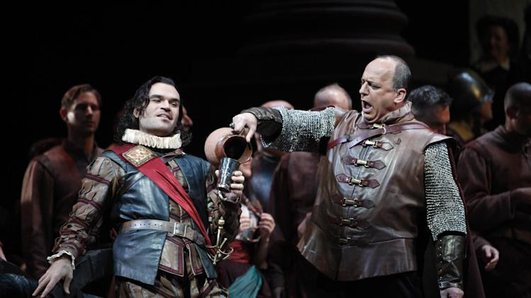 "In this Friday, Oct. 5, 2012 photo, Michael Fabiano, left, performs as Cassio alongside Falk Struckman performing as Iago during the final dress rehearsal of Guiseppe Verdi's ""Otello"" at the Metropolitan Opera in New York.  (AP Photo/Mary Altaffer)"
