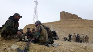 Syrian pro-government forces rest next to the Palmyra …