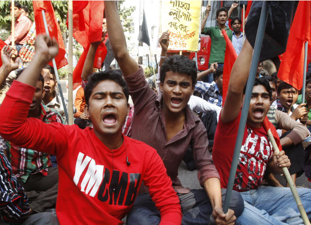 Bangladeshi garment workers shout slogans as they participate in a protest to mourn the death of the victims of a fire in a garment factory in Dhaka, Bangladesh, Friday, Nov. 30, 2012. Hundreds of gar