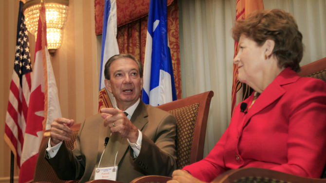 U.S. Sen. Jeanne Shaheen D-N.H. listens to Patrick Binns, Consul General of Canada to New England, during a forum Monday, Aug. 13, 2012 in Concord, N.H. aimed at improving trade between New Hampshire and eastern Canadian provinces. Organized by the New Hampshire-Canada Trade Council, Monday's conference includes sessions on trade opportunities in the areas of education, energy, manufacturing, public-private partnerships and women's entrepreneurship.  (AP Photo/Jim Cole)