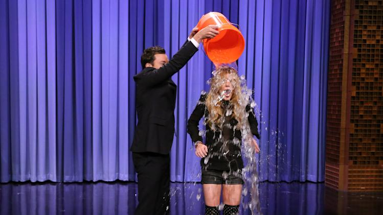 "This Aug. 20, 2014 photo released by NBC shows host Jimmy Fallon, left, dumping a bucket of ice water over the head of actress Lindsay Lohan as she participates in the ALS Ice Bucket Challenge on ""The Tonight Show Starring Jimmy Fallon,"" in New York. The phenomenal success of the fundraising craze is making charitable organizations rethink how they connect with a younger generation of potential donors, specifically through social media. (AP Photo/NBC, Douglas Gorenstein)"