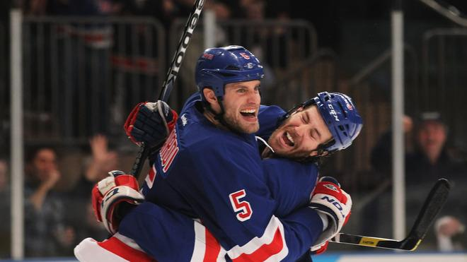 Dan Girardi #5 And Brandon Prust #8 Of The New York Rangers Celebrate Girardi's Second Period Goal Against The Ottawa Getty Images