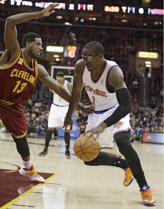 New York Knicks' Amare Stoudemire (1) drives past Cleveland Cavaliers' Tristan Thompson (13) during the first quarter of an NBA basketball game Saturday, March 8, 2014, in Cleveland. New York