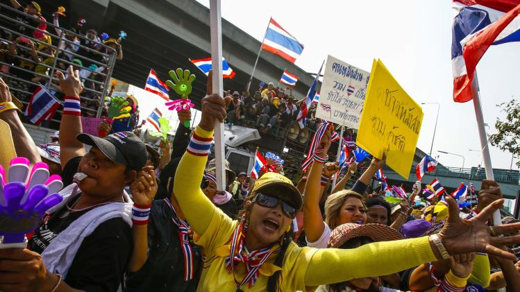 Anti-government protesters shout slogans as they gather outside the Army Club in Bangkok