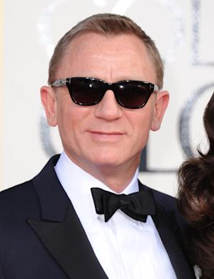 Actor Daniel Craig arrives at the 70th Annual Golden Globe Awards at the Beverly Hilton Hotel on Sunday Jan. 13, 2013, in Beverly Hills, Calif. (Photo by Jordan Strauss/Invision/AP)