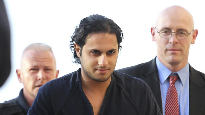 FILE - In this Feb. 25, 2011, file photo Khalid Ali-M Aldawsari is escorted to the Mahon Federal Building in Lubbock, Texas. A federal judge in West Texas Tuesday, 21, 2012, will hear evidence and arguments on the mental competency of Khalid Ali-M Aldawsari, accused of trying to make a weapon of mass destruction. (AP Photo/Lubbock Avalanche-Journal, Zach Long, File)