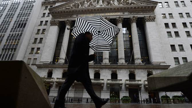 A pedestrian walks past the New York Stock Exchange the day after Pres. Barack Obama was re-elected, Wednesday, Nov. 7, 2012 in New York. The price of oil tumbled nearly 5 percent Wednesday, its biggest decline of the year, as traders shifted their focus back to the struggles of the global economy.  (AP Photo/Henny Ray Abrams)