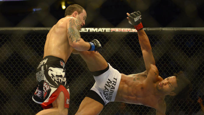 Benson Henderson from Arizona, right,  and Frankie Edgar from New Jersey fight in their middleweight title bout during UFC 150 in Denver, Saturday, Aug. 11, 2012. Henderson won the title bout. (AP Photo/Jack Dempsey)