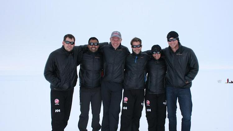 (R-L) Britain's Prince Harry, Kate Philp, Guy Disney, Richard Eyre, Ibrar Ali and Duncan Slater of Team UK in the South Pole Allied Challenge 2013 expedition, as they arrive in Novo, Antarctica, for a charity trek to the South Pole