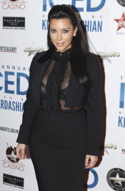 Hot mama-to-be! Kim Kardashian steps out in a revealing black ensemble to host ICED at Cowboys Dance Hall in Calgary, Canada on January 4, 2013  -- Getty Images