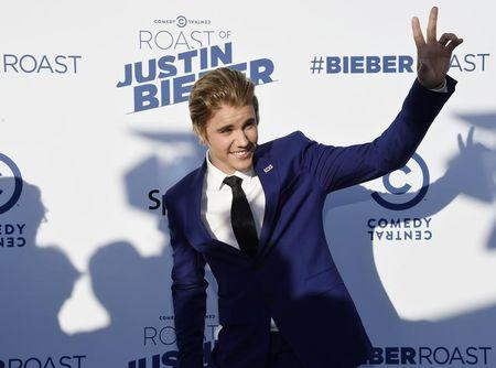 Pop star Justin Bieber settles lawsuit with Florida photographer