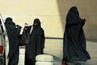Saudi women arrive at a shopping mall in Riyadh on January 12, 2013. A group of hardline clerics protested outside the royal palace in Riyadh against the king's decision to appoint 30 women to the kingdom's top advisory body, a YouTube video posted on Wednesday showed