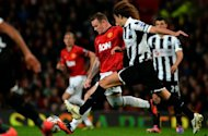 Manchester United's Wayne Rooney (C) fights for the ball with Newcastle United's Fabricio Coloccini during the third round match of the English League Cup, at Old Trafford in Manchester, north-west England, on September 26. Man United won 2-1