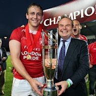 London Welsh captain Jon Mills (left) and chairman Bleddyn Phillips with their Championship trophy