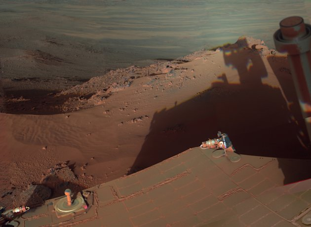 In this undated image provided by NASA, Mars Rover Opportunity catches its own late-afternoon shadow in a view eastward across Endeavour Crater on Mars. The rover used a panoramic camera between about