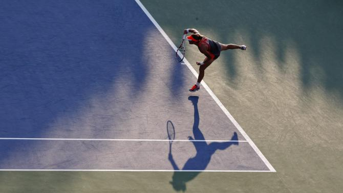 Samantha Stosur, of Australia, serves to Britain's Laura Robson in the third round of play at the 2012 US Open tennis tournament,  Sunday, Sept. 2, 2012, in New York. Stosur won the match. (AP Photo/Mel C. Evans)