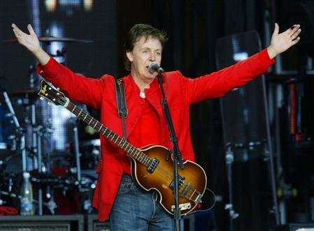 Reuters/Reuters - British singer and songwriter Sir Paul McCartney greets spectators at the begining of his concert in the Czech Republic capital of Prague, June 6, 2004. REUTERS/Petr Josek