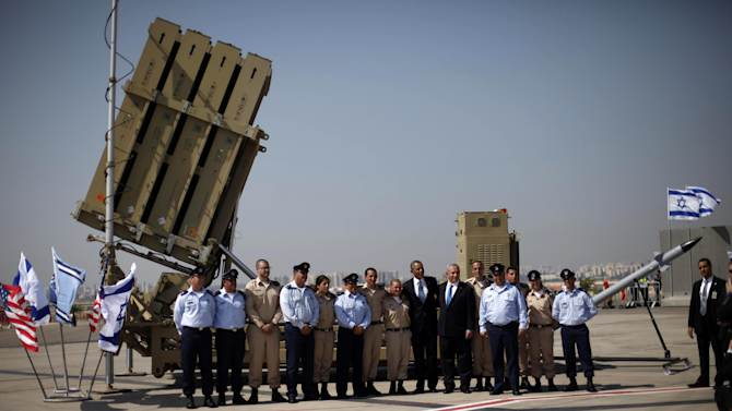 President Barack Obama, Israeli Prime Minister Benjamin Netanyahu, and others, pose for a group photo while touring the Iron Dome Battery defense system, Wednesday, March 20, 2013, at Ben Gurion International Airport in Tel Aviv, Israel. (AP Photo/Pablo Martinez Monsivais)