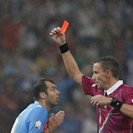 Referee Paolo Mazzoleni shows a red card to Napoli's forward Goran Pandev, left, during the Italian Super Cup match between Napoli and Juventus at China's National Stadium in Beijing, Saturday, Aug. 11, 2012. Juventus won 4-2. (AP Photo/Alexander F. Yuan)