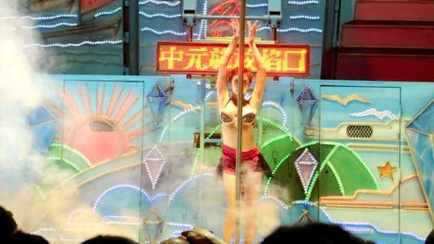 These Taiwanese showgirls strip to appease the wandering spirits. (AFP photo)