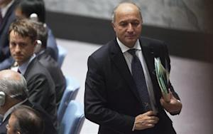France's Minister of Foreign Affairs Fabius walks out during Security Council meeting on small arms, during the 68th United Nations General Assembly at U.N. headquarters in New York