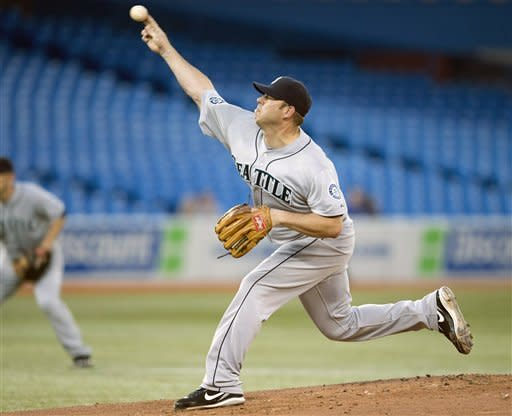 Millwood and Mariners beat Romero, Blue Jays 3-2
