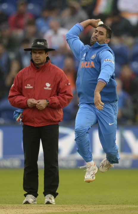 India's Dhoni bowls as umpire Dar looks on during ICC Champions Trophy semi final match against Sri Lanka at Cardiff Wales Stadium